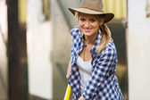 Cowgirl working in stables — Stock Photo