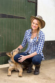 Country girl and her dog — Stock Photo