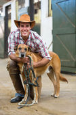 Horse farm owner and his dog — Stock Photo