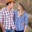 Cheerful couple in barn — Stock Photo #50640839