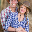 Young farming couple inside barn — Stock Photo #50640933