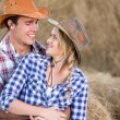 Loving american western couple in barn — Stock Photo #50641217