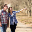 Couple bird watching outdoors in fall — Stockfoto