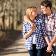 Young couple walking in countryside — Stock Photo #50643841