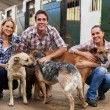 Group of farm workers with dogs — Stockfoto