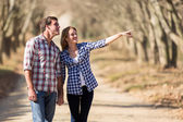 Couple bird watching outdoors in fall — Stock Photo