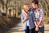 Young couple walking in countryside — Stock Photo