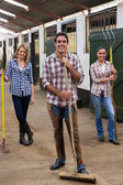 Group of farm workers with tools — Stock Photo