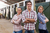 Farm workers with arms crossed — Stock Photo
