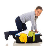 Girl packing suitcase — Stock Photo
