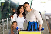 Beautiful family at airport — Stock Photo