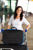 Woman with trolley — Stock Photo