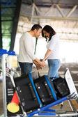 Man comforting girlfriend at airport — Stock Photo