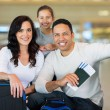 Family holding boarding pass — Stock Photo