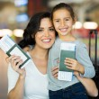 Mother and daughter holding passports — Stock Photo #51626075