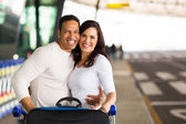 Embracing couple at airport — Stock Photo