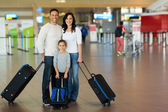 Family with suitcases — Stock Photo