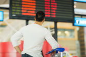 Traveller looking at airport information — Stock Photo