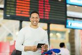Man holding passport — Stock Photo