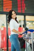Woman near airport information board — Stock Photo