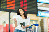 Woman looking at ticket — Foto de Stock