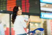 Woman holding passport — Stock Photo