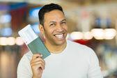 Man holding passport and boarding pass — Stock Photo