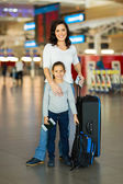 Mother and daughter with luggage — Stock Photo