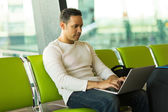 Middle aged man using laptop — Stock Photo