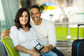 Couple waiting for flight at airport — Stock Photo