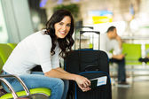 Woman waiting for flight — Stock Photo