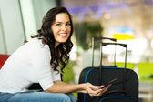 Female traveller using computer — Stock Photo