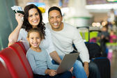 Girl with parents using laptop — Stock Photo
