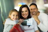 Girl with parents at airport — Stock Photo
