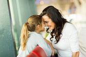 Mother and daughter at airport — Stock Photo