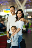 Parents with daughter at airport — Stock Photo