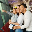 Girl and parents at airport — Stock Photo #51668807