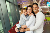 Embracing family at airport — Stock Photo