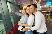 Girl and parents at airport — Stock Photo