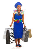 Woman carrying shopping bags — Stock Photo