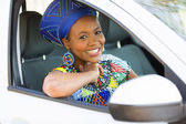 African woman inside car — Stock Photo