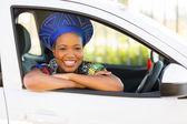 African girl inside new car — Stock Photo