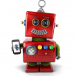 Vintage robot with smartphone — Stock Photo