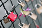 Red padlock with studded heart — Stock Photo