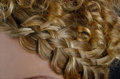Blonde hair braided in a braid — Stock Photo