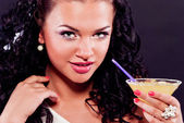 Sexy brunette drinking cocktail — Stock Photo