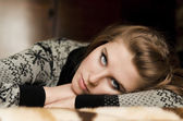 A pretty young woman lying on her arms — Stock Photo