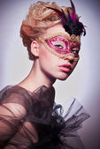 Beautiful woman in Venetian mask — Stock Photo