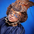 Beautiful woman in venetian mask with feathers and jewelry — Stock Photo