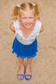 Playful, cheerful girl with two tails, looking from the bottom t — Stock Photo